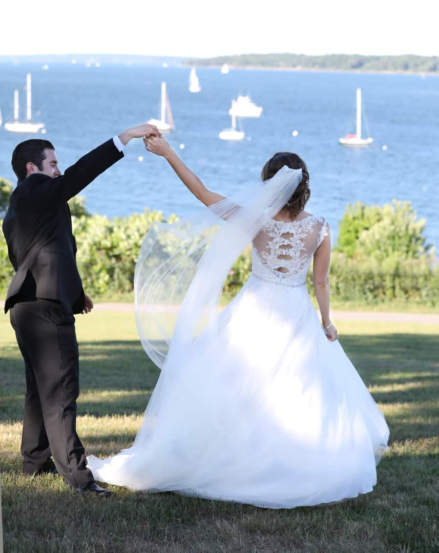 Bride and groom dancing near the ocean