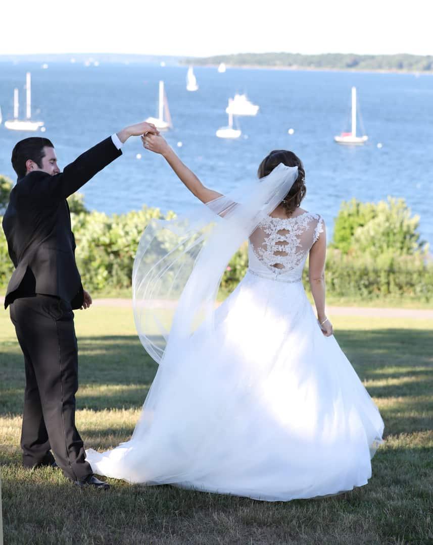 Bride and groom dancing near the ocean