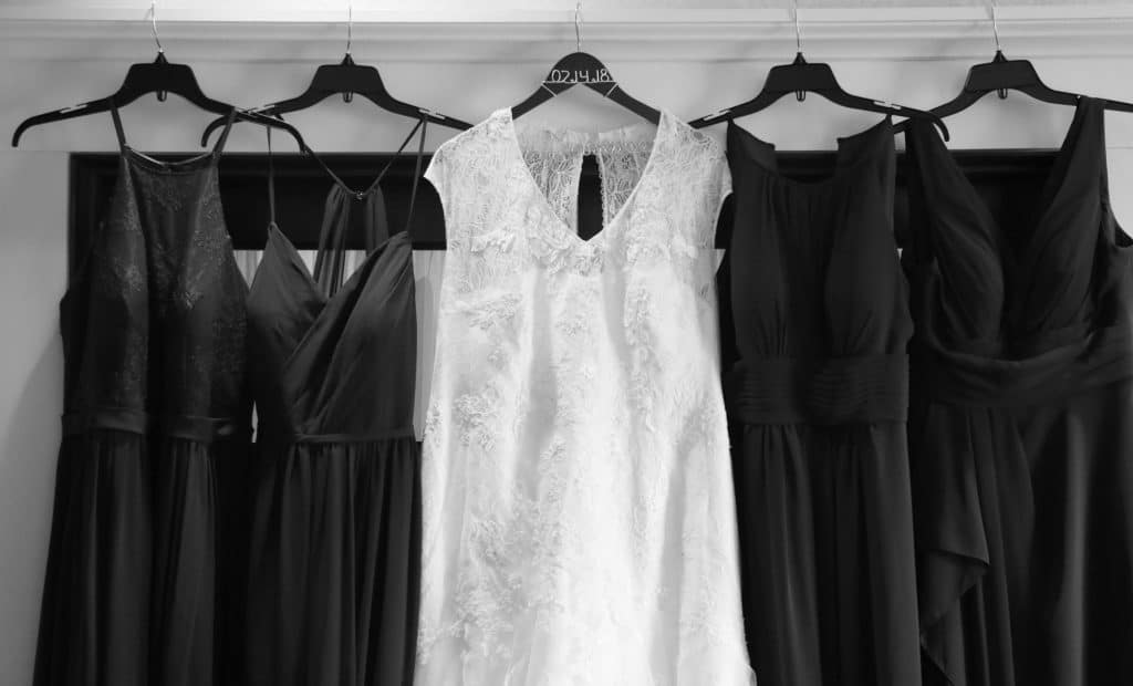 Wedding dress and bridsmaids dresses hanging together